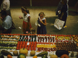 1955: Fairgoers as They Look at a Display of Produce at the Iowa State Fair  Des Moines  Iowa