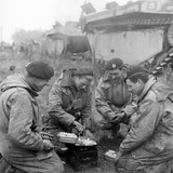 Members of the British 49th Armoured Personnel Carrier Regiment Cooking on the Side of a Road
