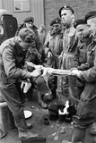 Members of the British 49th Armoured Personnel Carrier Regiment Skin a Rabbit for a Meal