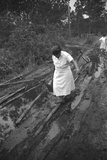 Nurse Maude Callen Carrying Her Medical Bag Along a Muddy Road after Caring for a Patient  1951