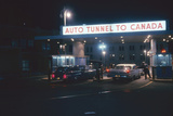 Nighttime View of the Cars at the Entrance to the Detroit-Windsor Tunnel  Detroit  Michigan  1959