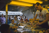 In a Booth at the Iowa State Fair  a Man Demonstrates 'Feemsters Famous Vegetable Slicer'  1955