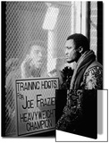 Boxer Muhammad Ali Taunting Boxer Joe Frazier During Training for Their Fight