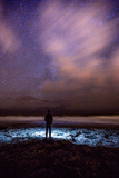 Silhouette of Man Watching Waves Beneath the Milky Way