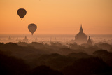 Hot Air Balloons Float Above the Terraces of a Buddhist Temple in Bagan