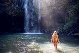 A Young Woman in a Natural Pool at the Base of a Waterfall